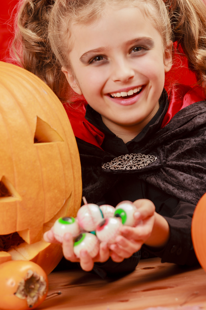 image of child with halloween sweets