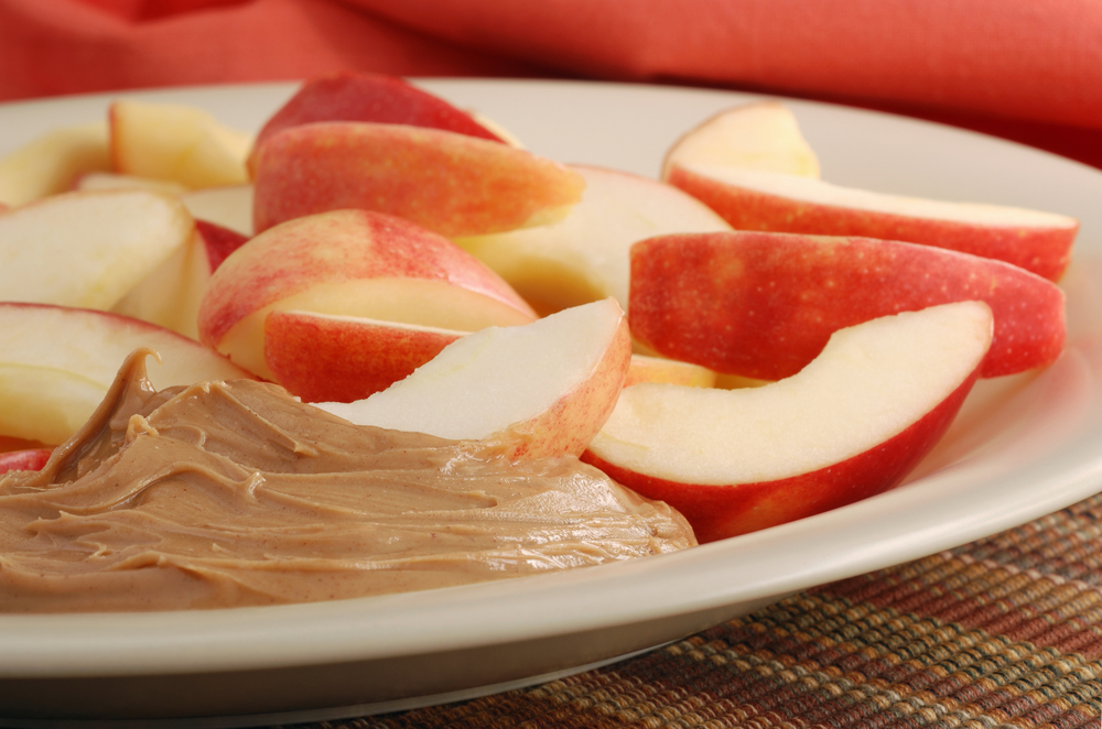 Apple slices with peanut butter spread